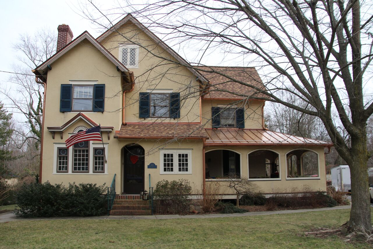 Historical roof restoration with LandMark Pro Shingles and copper standing seamed roof
