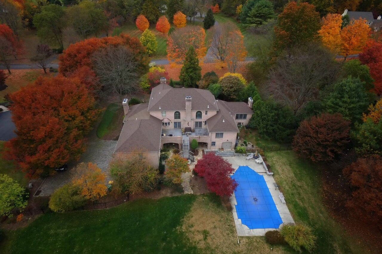 Fall colored trees near home with new roof in Thornton Pa