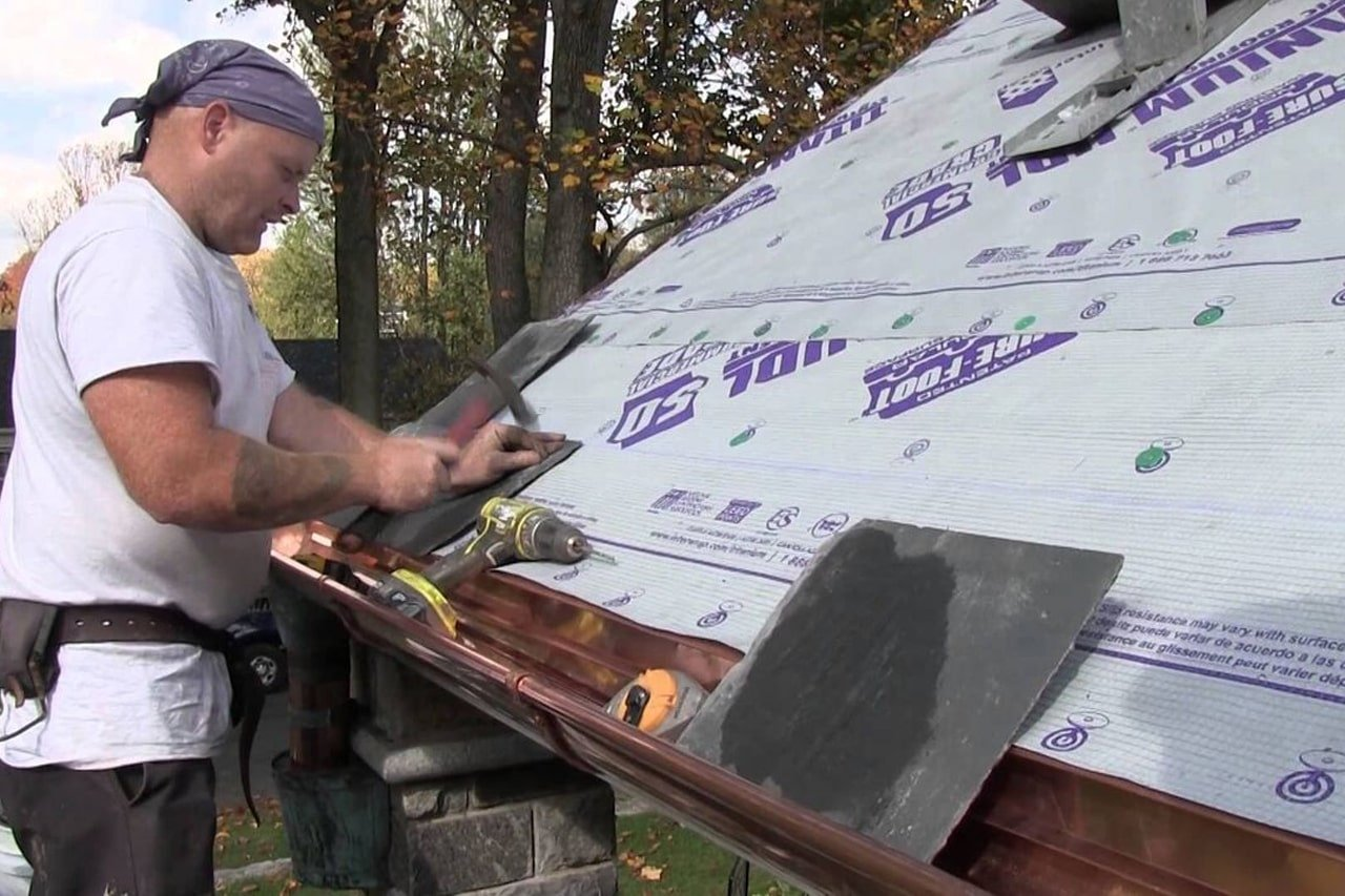 roofer repairing a storm damaged slate roof in Wyomissing Pa
